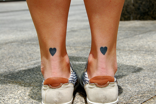 Motivational Hearts Tattoo On Back Heels For Girls