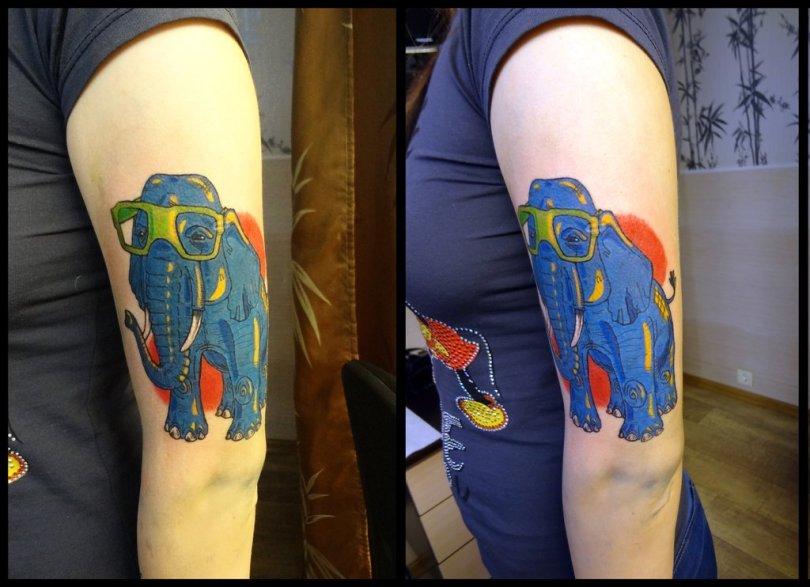 Nice Elephant Tattoo Design On Biceps For Women