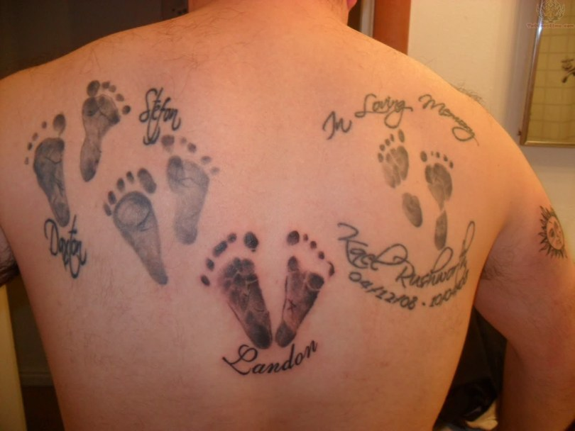 Nice Foot Prints Remembrance Tattoo On Back For Boys