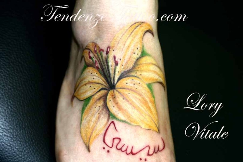 Out Standing Flower Tattoo On Foot For Girls
