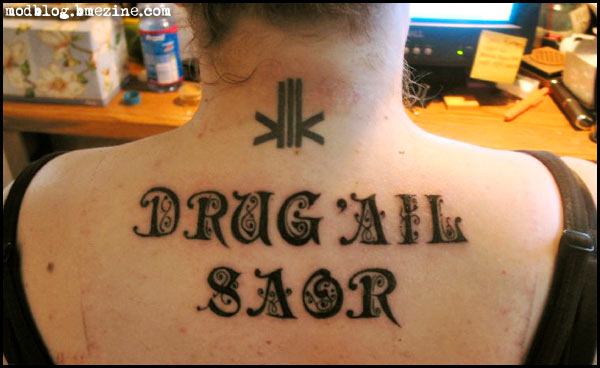 Passionate Drug All Saor Tattoo On Upper Back For Girls