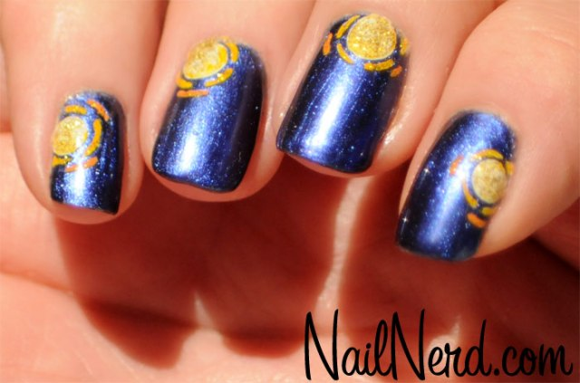 Sensational Blue Nail Art With Golden Sun Design