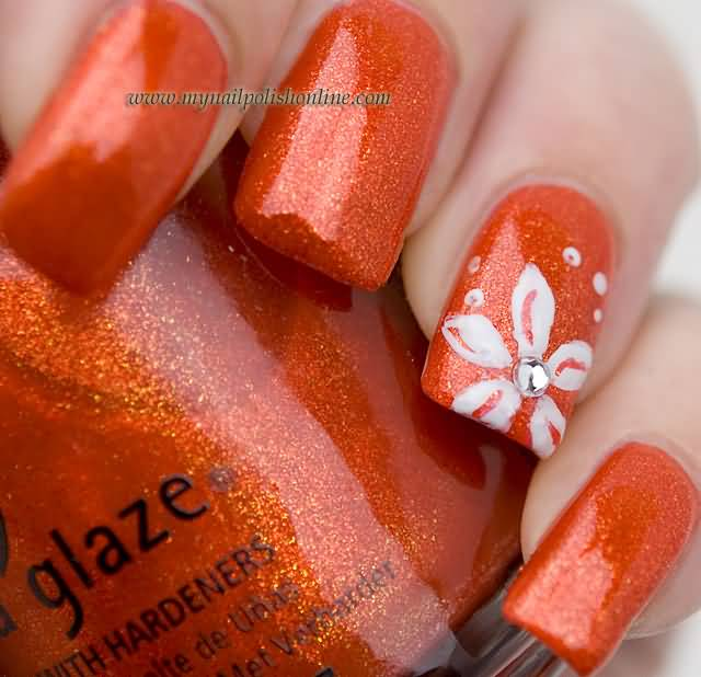 Sparkle Orange Color With White Flower Accent Nail Art