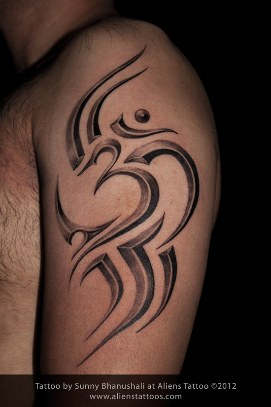 Stunning Tribal Om Tattoo On Biceps For Boys