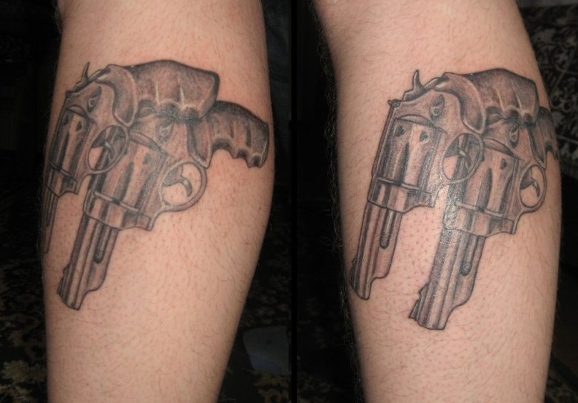 Superb Gun Tattoo Design For Boys