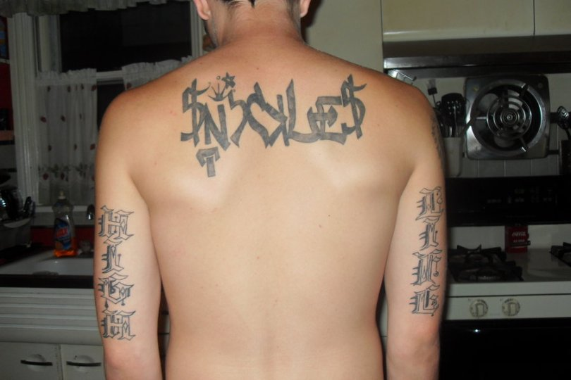 Sweet Graffiti Tattoo Design On Upper Back For Boys