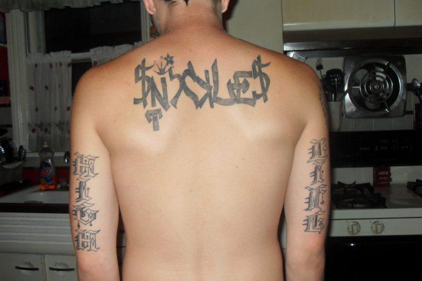 Sweet Graffiti Tattoo Design On Upper Back For Boys