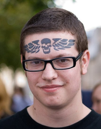 Traditional Winged Skull Forehead Tattoo Design For Boys