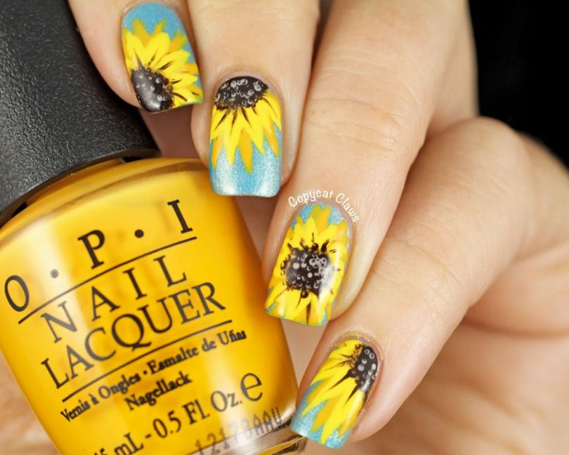 Trending With Sun Flower Yellow And Blue Nails
