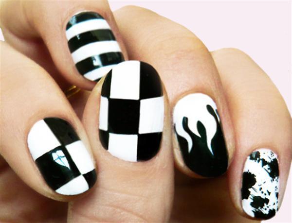 Unique Black Nail Art With White Color Paint