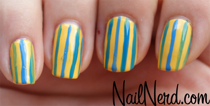 Unique Lining Design Yellow And Blue Nails