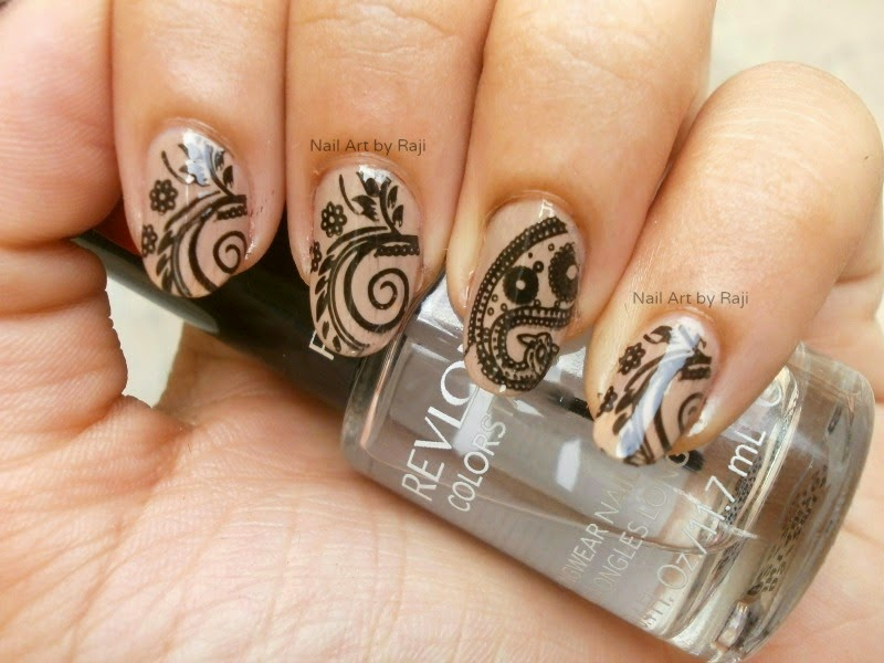 Wonderful Black And Beige Nail Art With Leaves Design