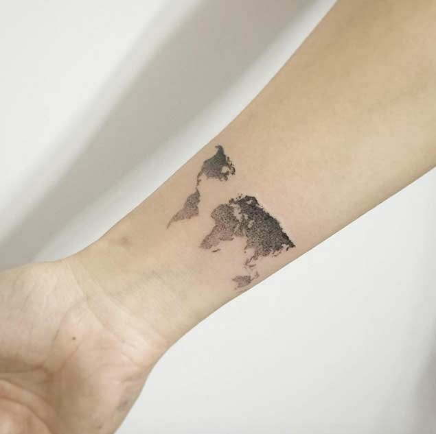 Adorable World Map Tattoo On Arm for girls