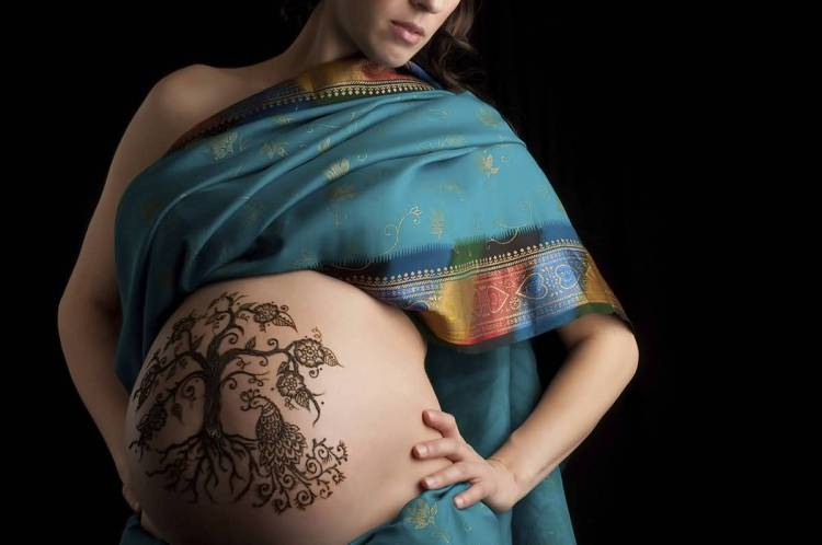 cool pregnancy tattoo on stomach