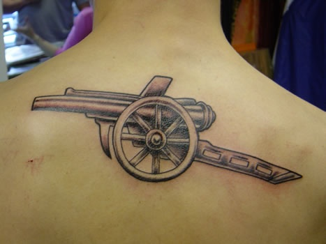Impressive Cannon Tattoo For men's back