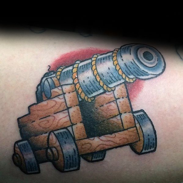 Weird Cannon Tattoo On Back shoulder