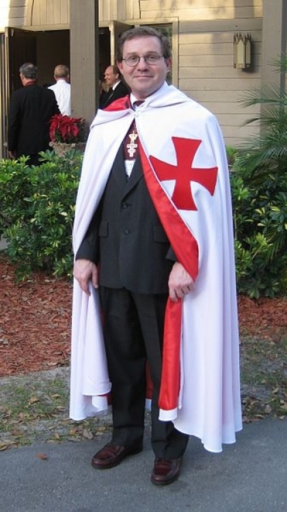 A man induced into the Knights Templar (Freemasonry) in 2009. Note the Maltese Cross.