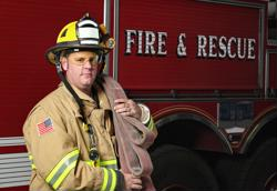 Firefighters fired up over new helmet policy