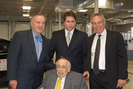Four generations as Rogers Pontiac to now Rogers Auto      Group | Roger Scher (seated) | From left Mayor Richard Daley, John      Scher, and Monty Scher