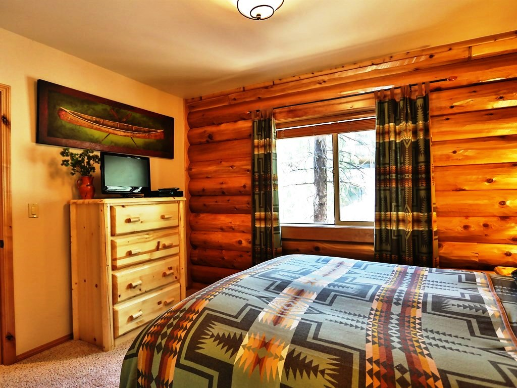 This bedroom includes a lovely four drawer dresser and a high-definition television with access to cable.
