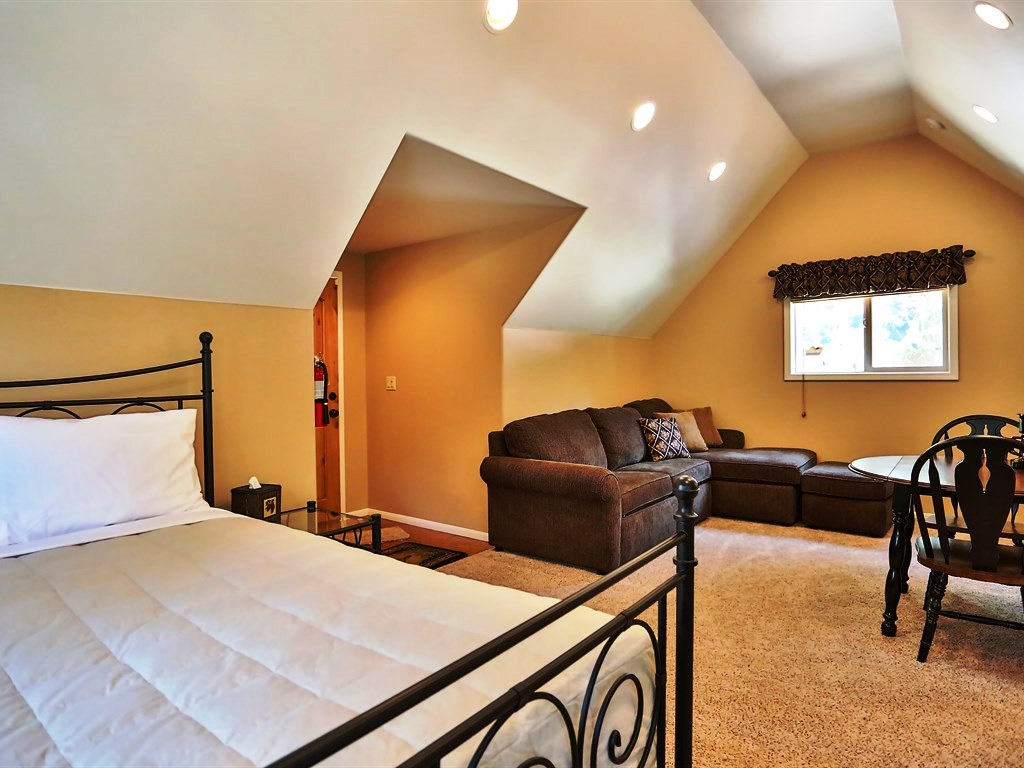 High ceilings and a comfy/cozy hangout area make this the ideal master bedroom.