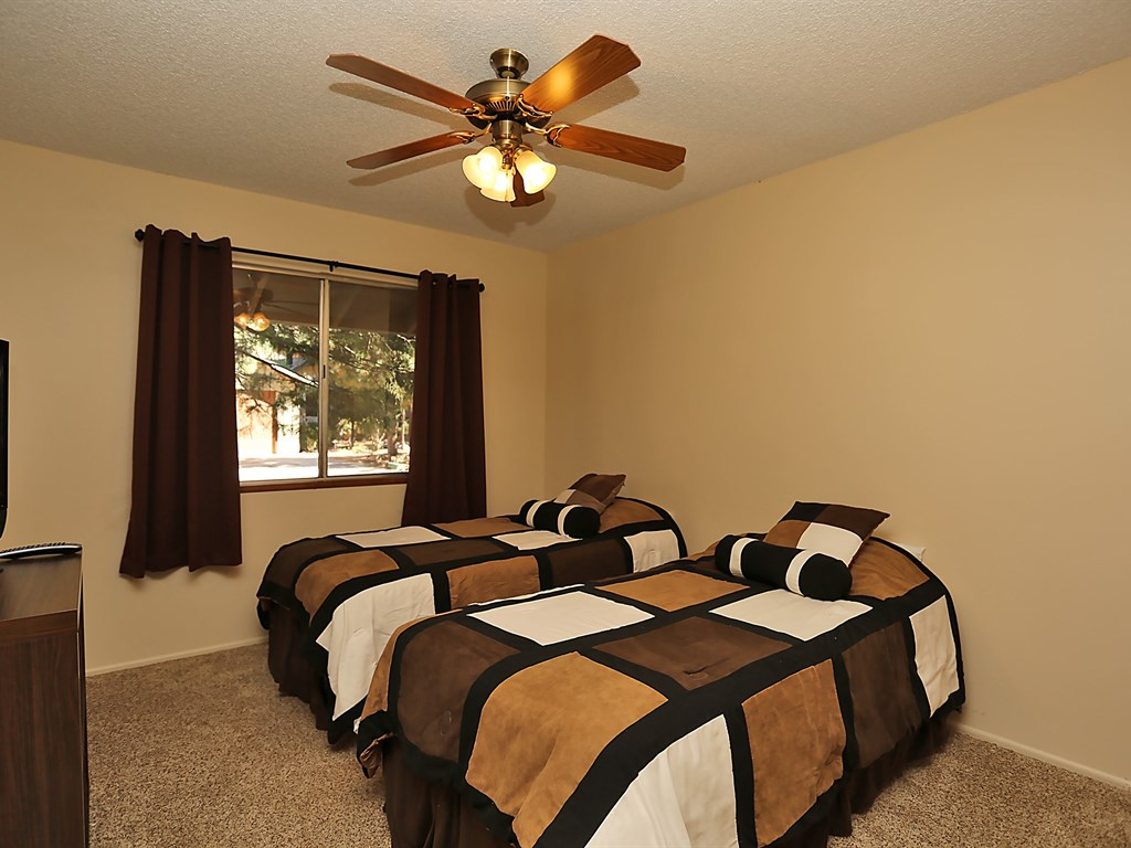 This bedroom includes two twin size beds and a high definition T.V. with access to cable.