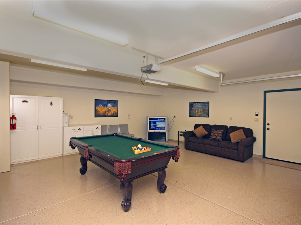 This room is spacious, fun and comfortable! The Pool Table, space, and comfy sofa make it the perfect hang-out area for families with children, groups or anyone wanting to relax and have some fun.
