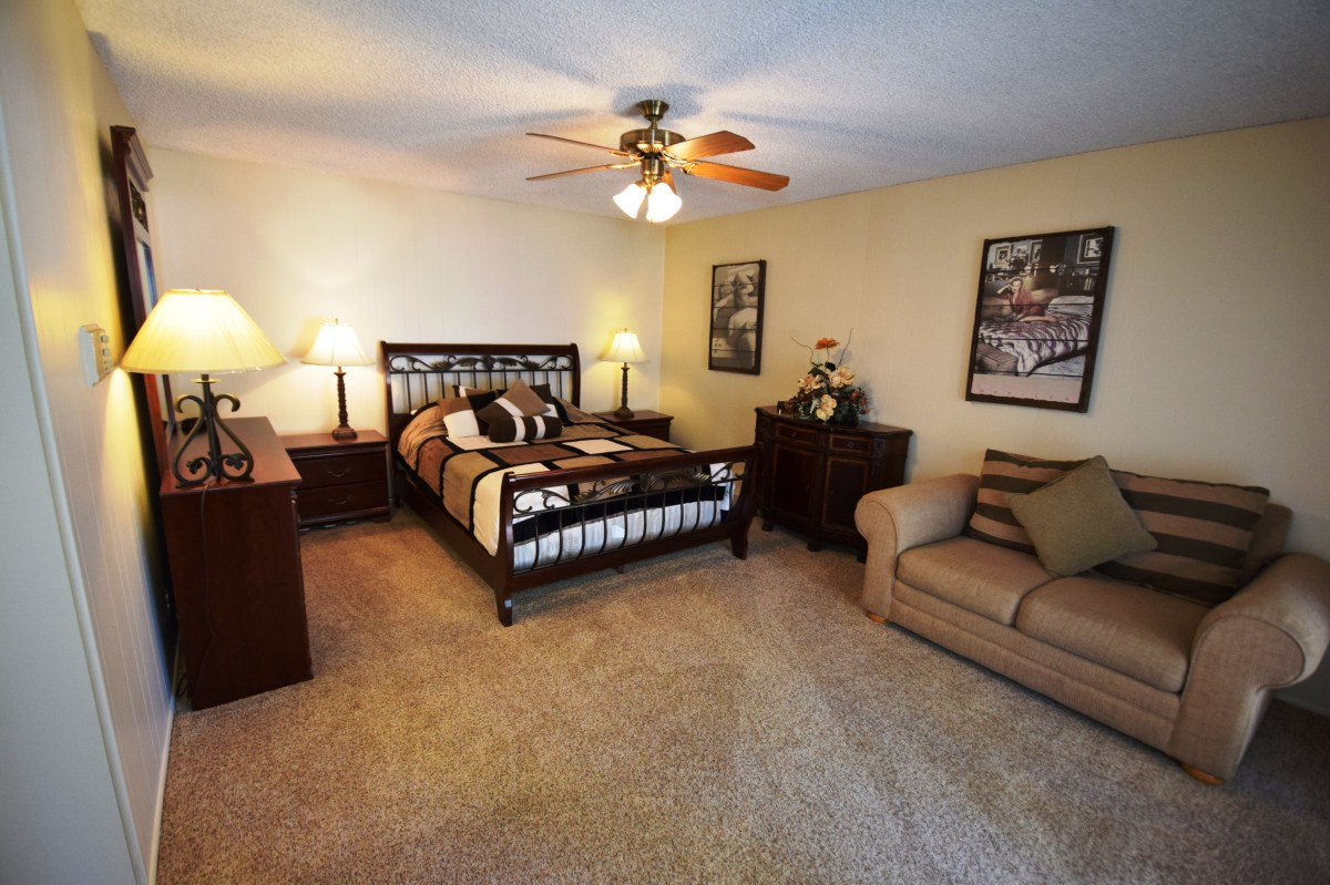 Includes lovely carpet, sofa, and a queen size bed.