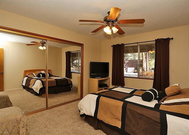 This bedroom includes one double size bed and a high definition T.V. with access to cable.