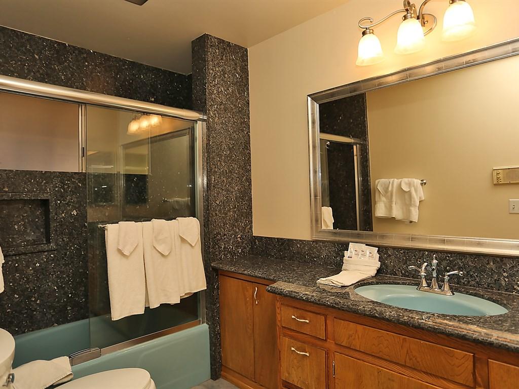 Beautiful bathroom with large shower/bath and modern feel.