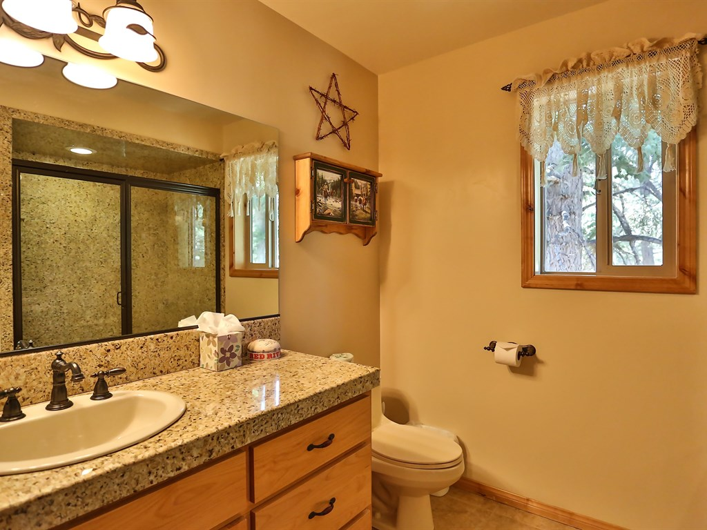 Includes a huge shower and beautiful granite counter-tops.