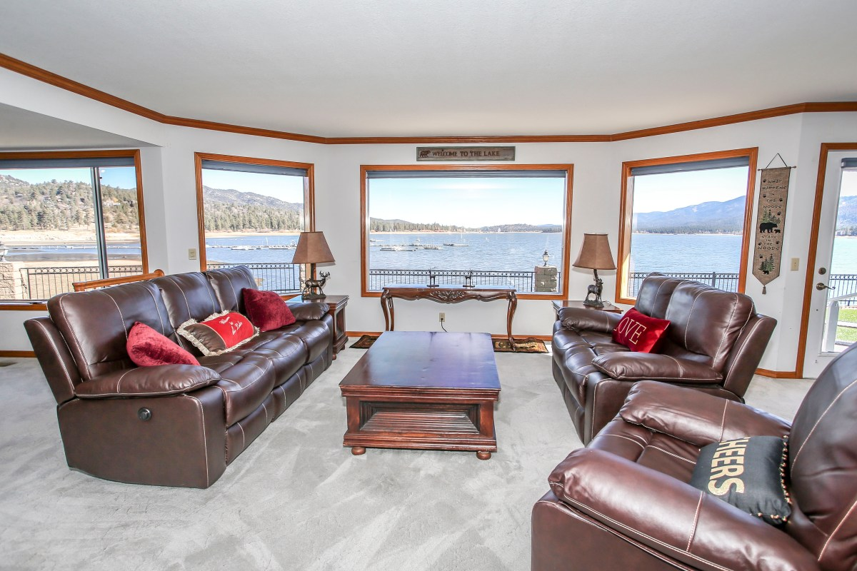 One of the most beautiful lakefront properties in Big Bear! Relax in comfort in this modern living room with views of Big Bear Lake.