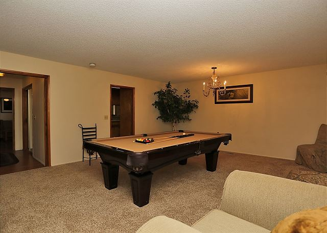 This room includes comfy seating and a pool table.