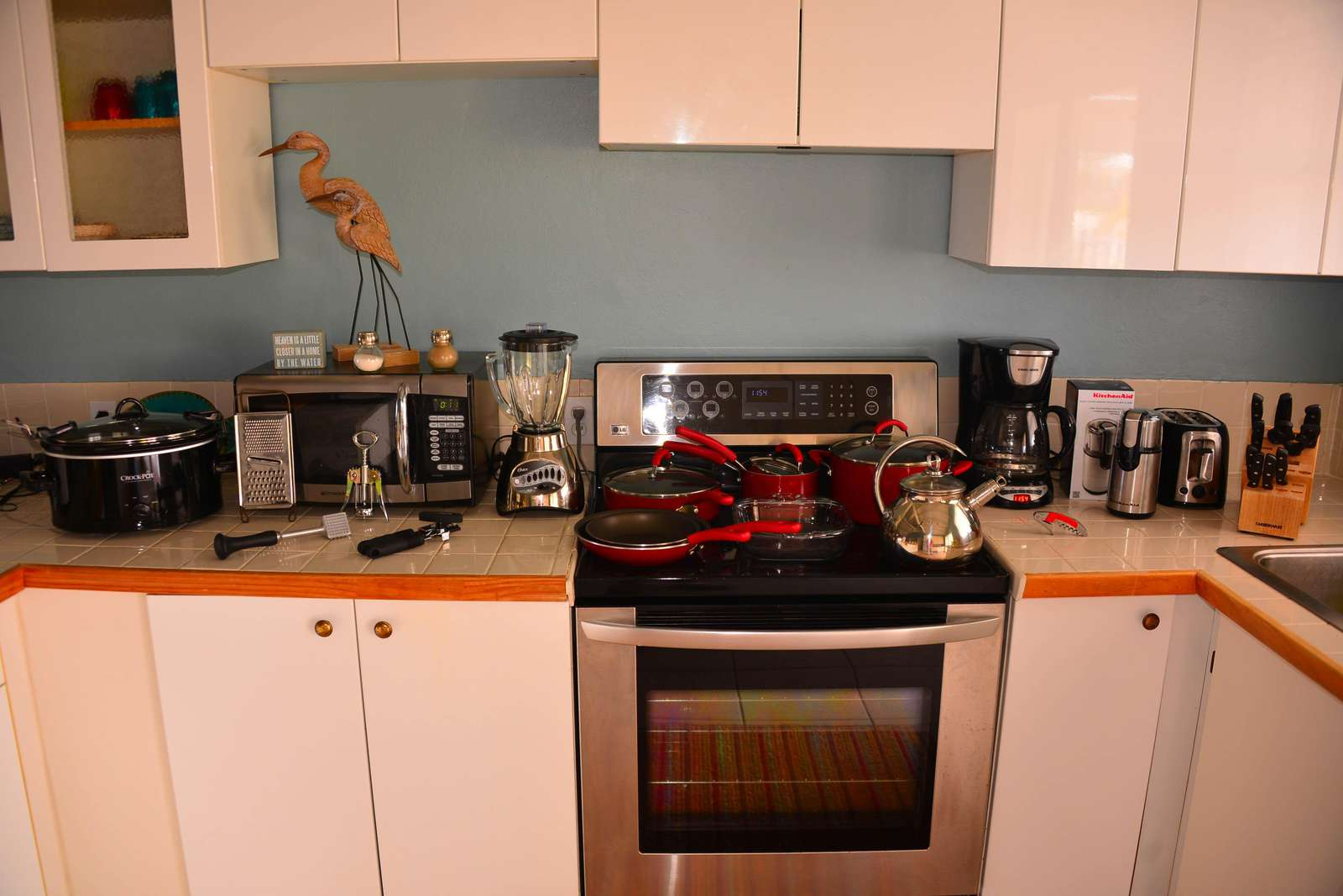 Fully stocked kitchen items (old countertops)