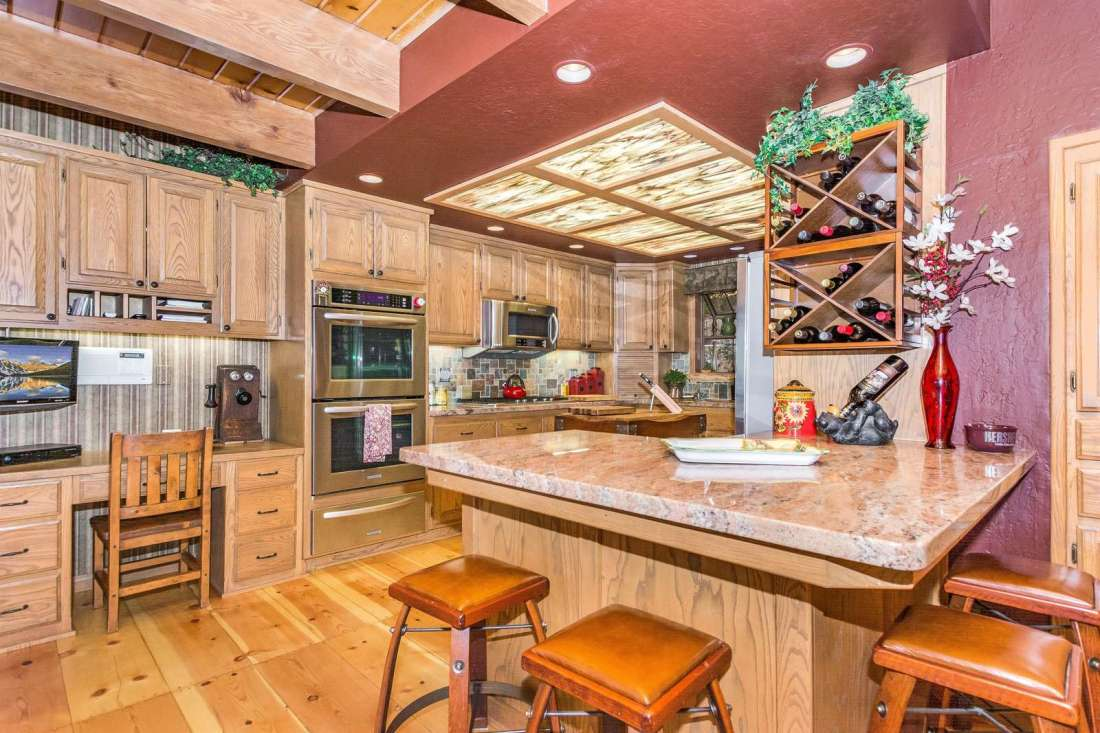 Gourmet kitchen with updated appliances and breakfast bar