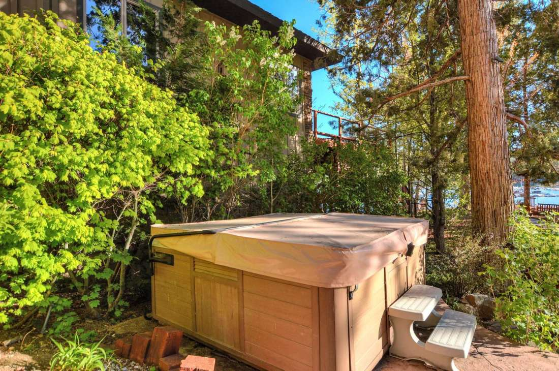 Hot Tub has room for 6-8 and is situated amongst the trees