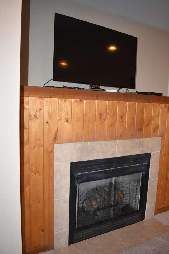 Gas fireplace and widescreen tv in Game Room