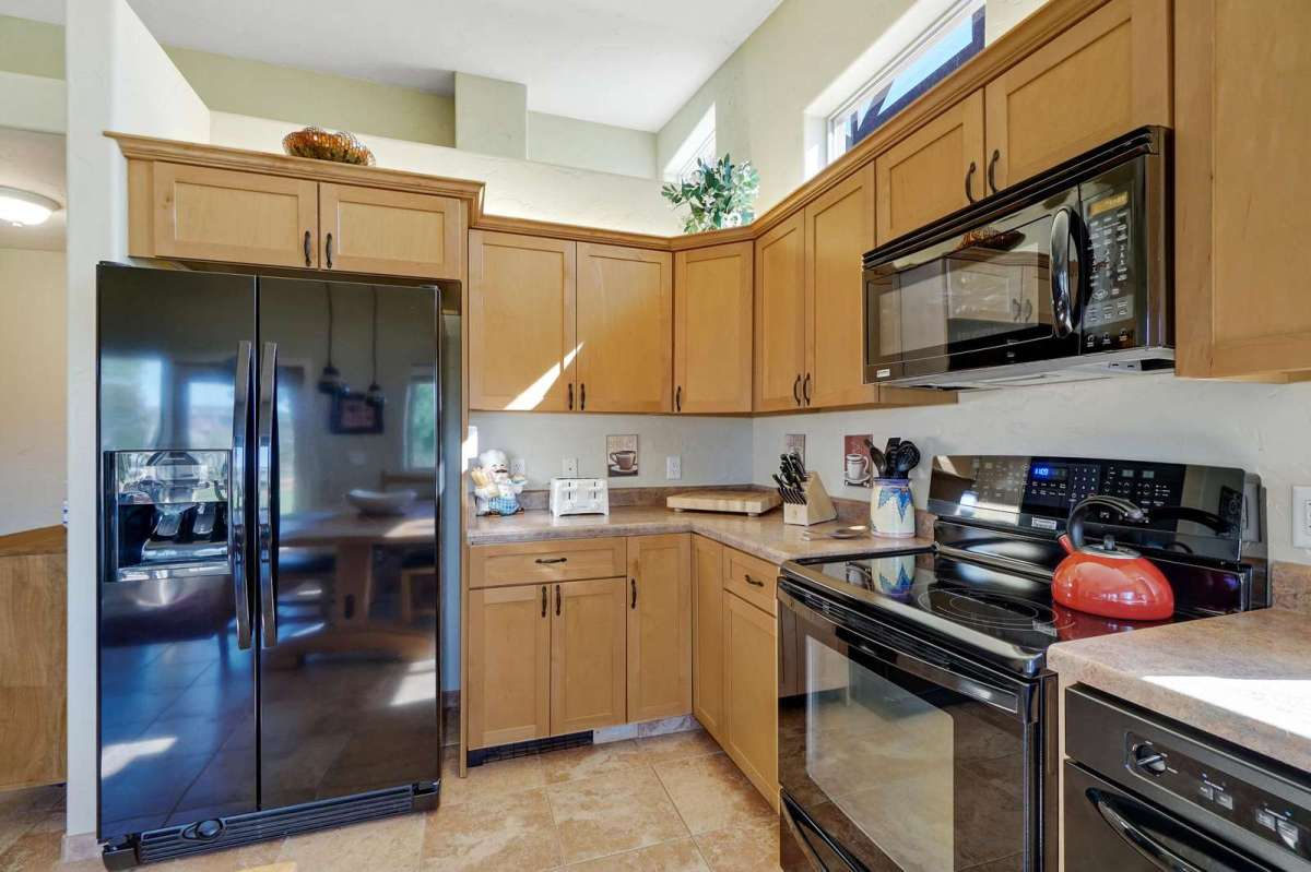 Enjoy a open kitchen equipped with pots and pans.