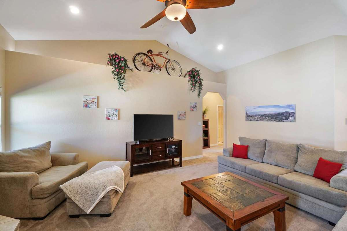 This beautiful living room offers lots of space, comfortable seating and Smart TV