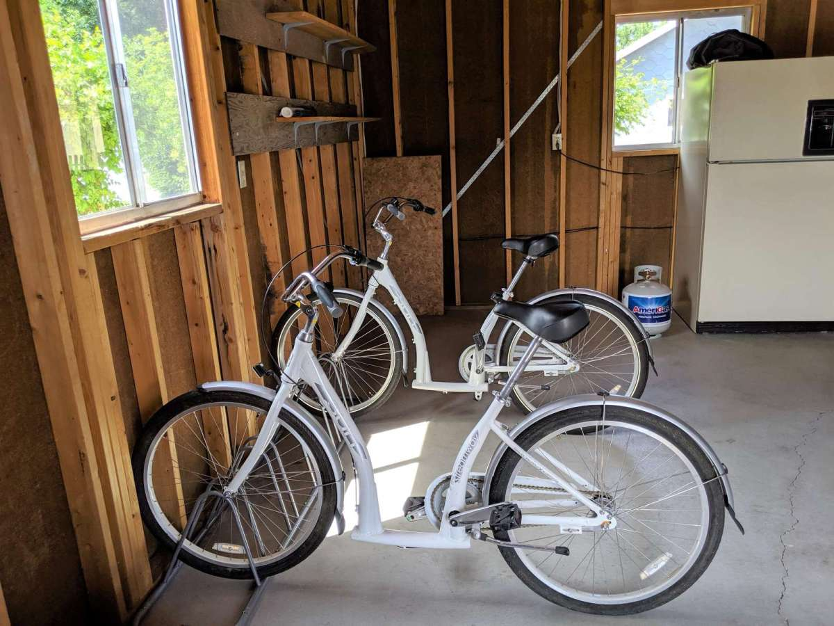 2 Cruiser Bikes and a Bike Rack Located in the Garage