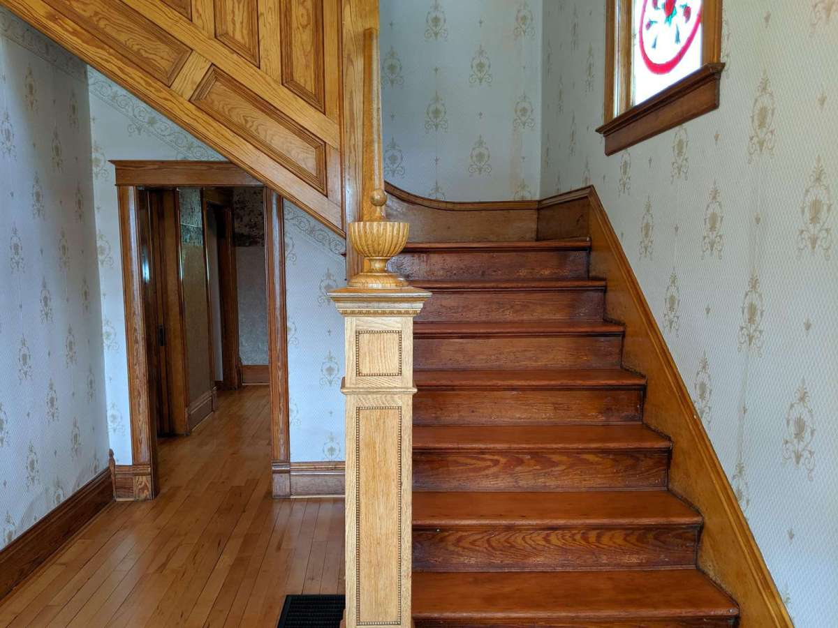 Front entrance hallway with beautiful wood staircase