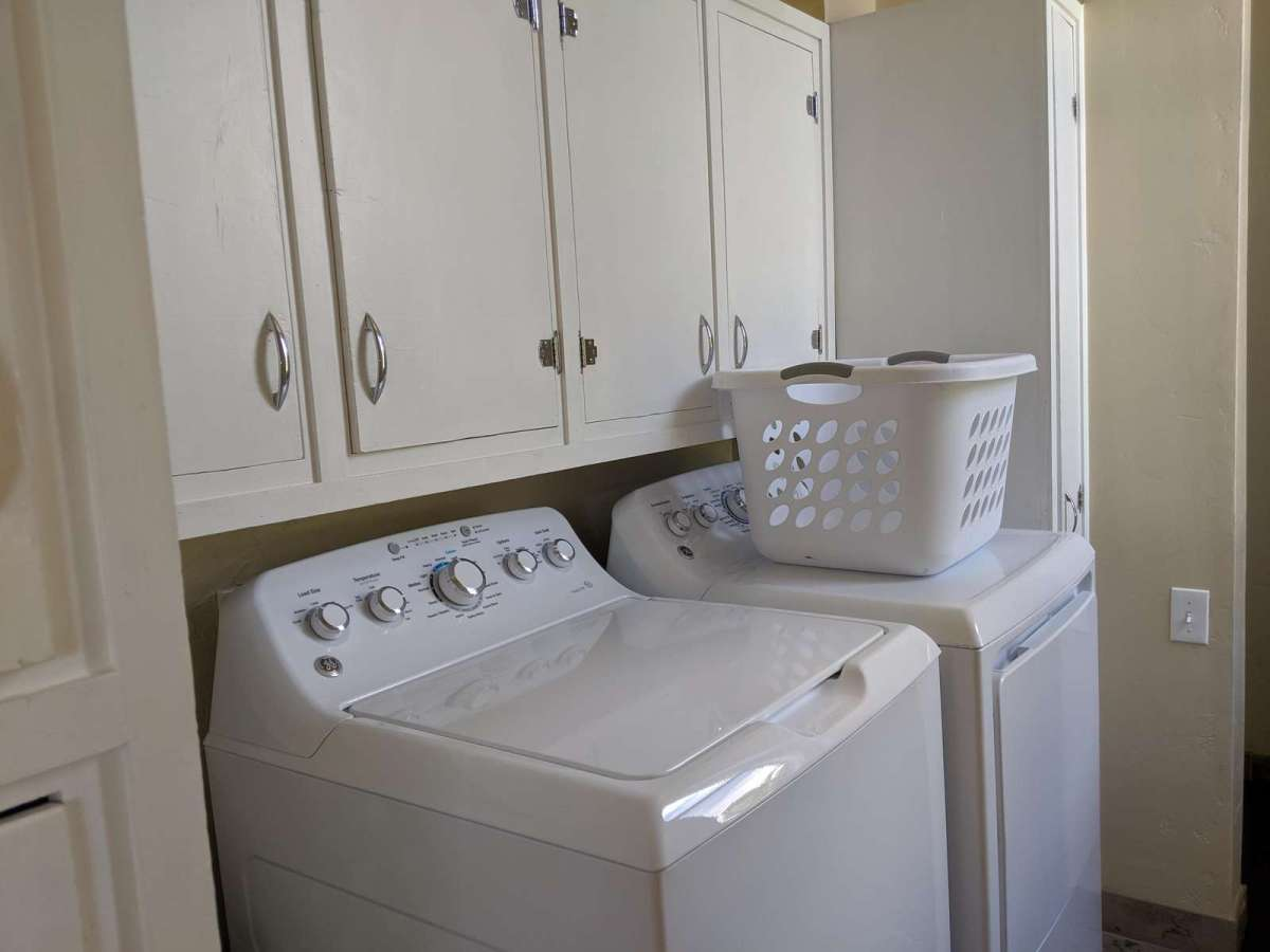 Full size washer and dryer located on the main level right off the kitchen