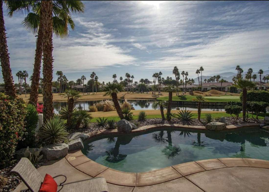 Large pool and 8 person hot tub overlooking lake and 12th green