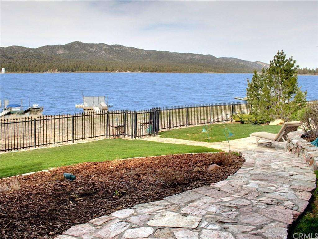 Over 100 feet of lake front, fenced property.