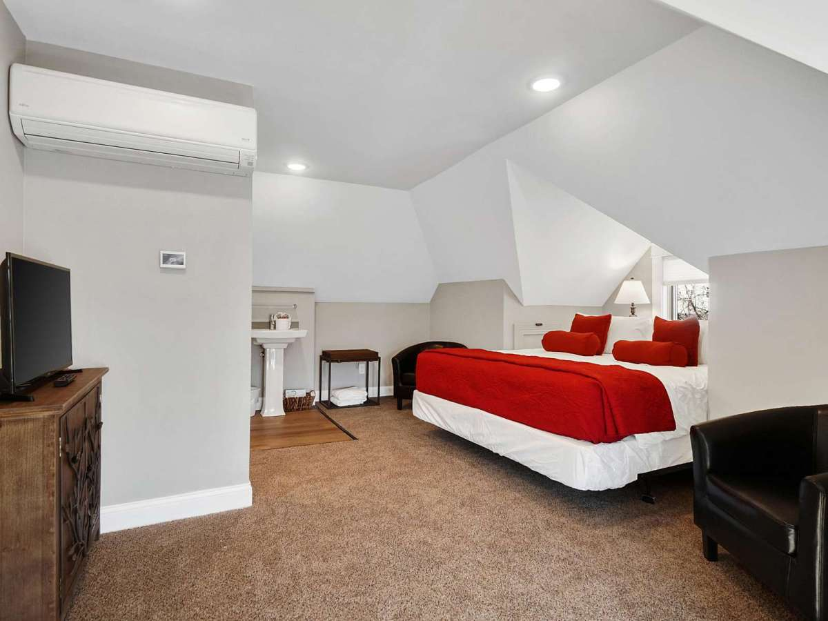 Enjoy your shows from our beautiful master bedroom.