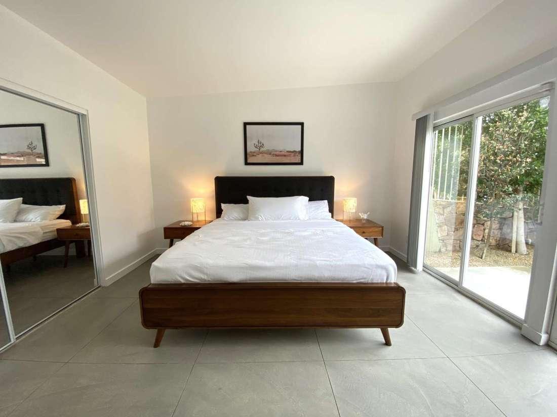Bedroom 1 with sliding door to the backyard