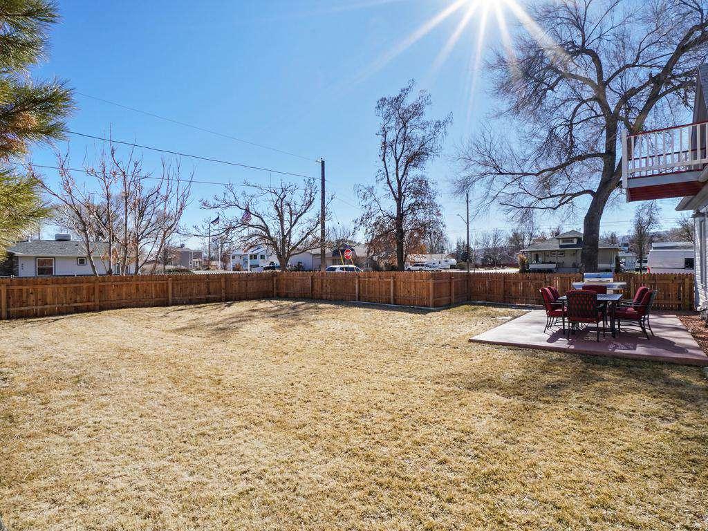 Fully fenced backyard so the fur babies can run around