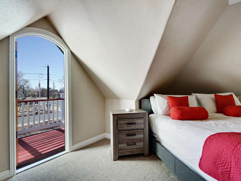 Master bedroom has a balcony that over sees the backyard.