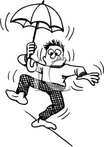 Man Walking On A High Wire Holding An Umbrella