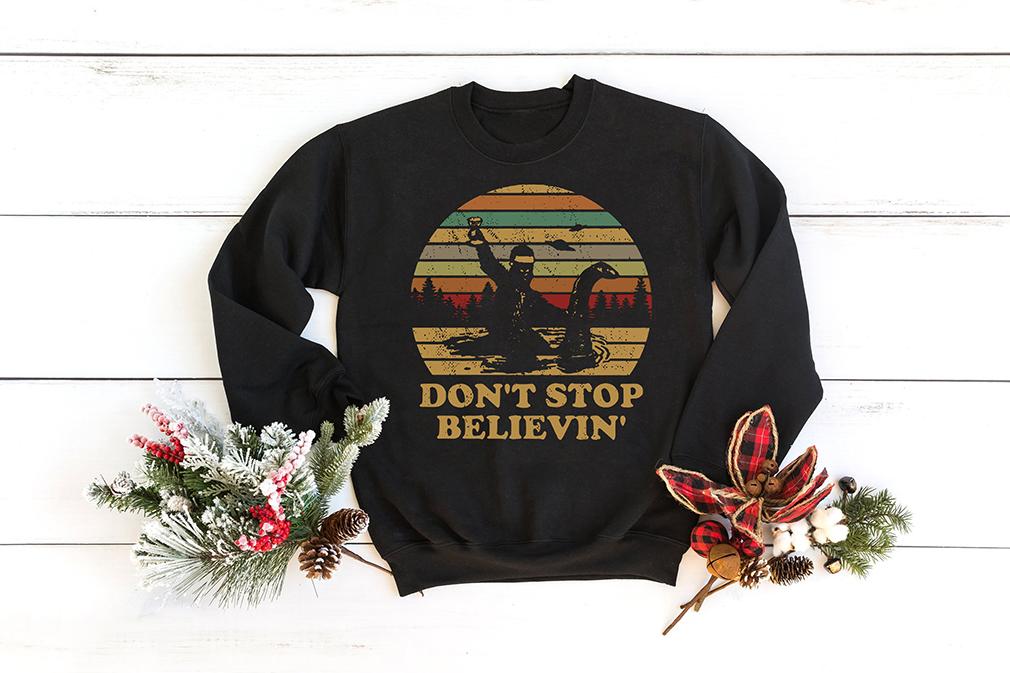 Christmas Vintage Bigfoot Santa riding on Nessie don't stop believin' shirt